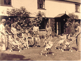 Owen Maclaren with Baby Buggies outside Arnold House